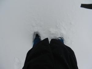 Pés afundados na neve